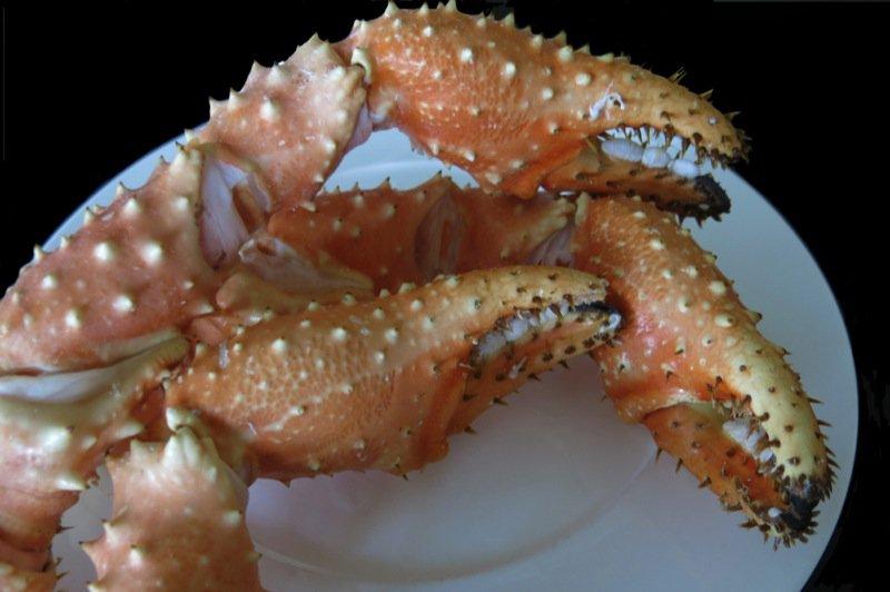 8 Three Alaska King Crab Claws on Plate