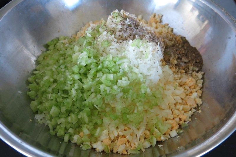10 egg onion celery salt pepper in bowl